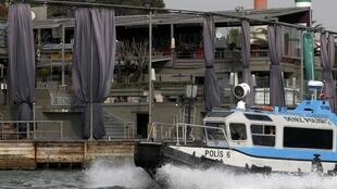 A Turkish coast guard boat patrols in front of the Reina nightclub in Istanbul which was attacked during New Year festivities.
