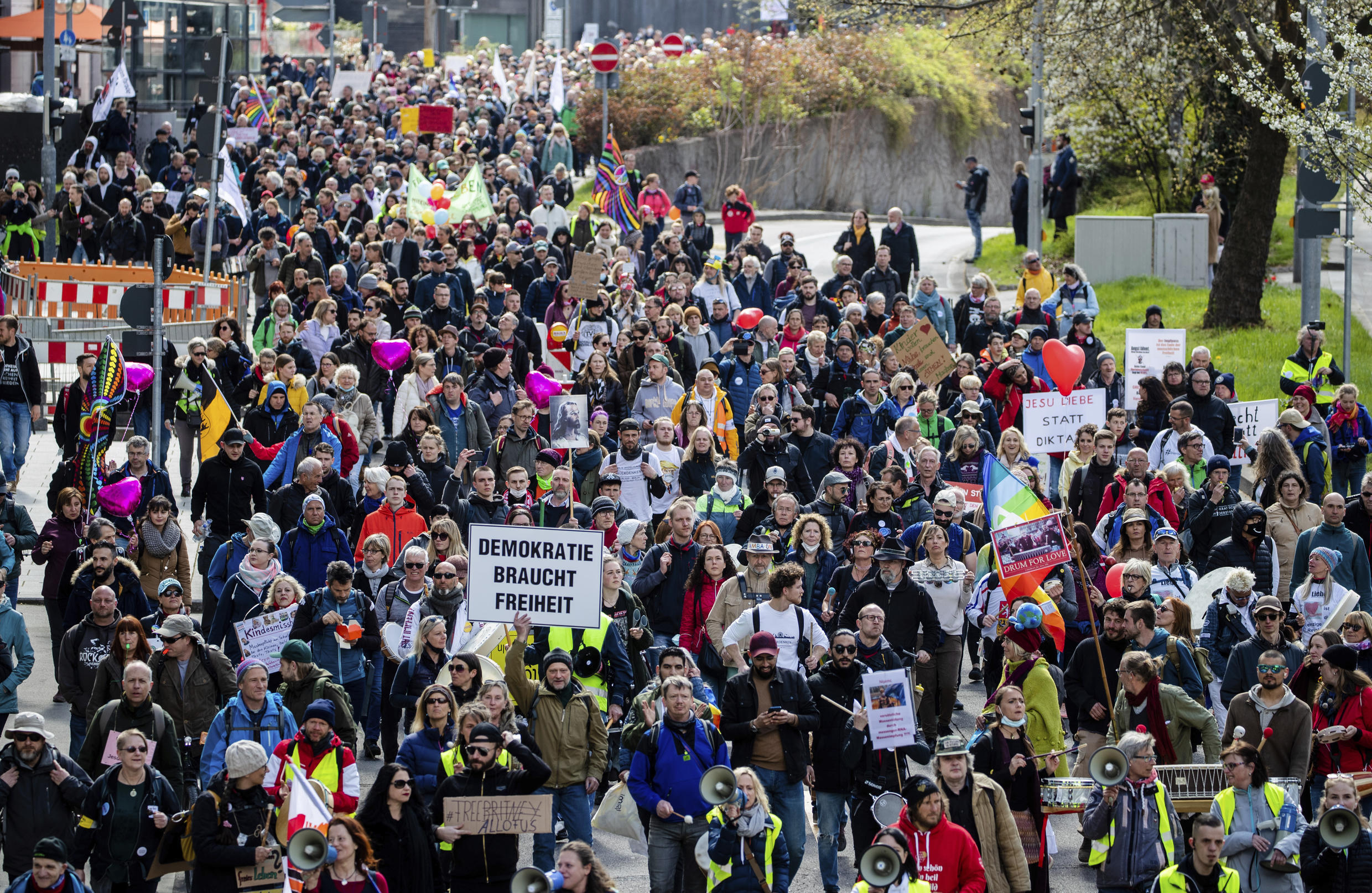 """People take part in a demonstration of the initiative """"Querdenken"""" through the city center in Stuttgart, Germany"""