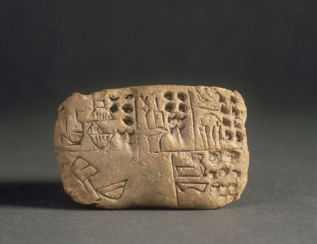 Tablette proto-cunéiforme administrative, Warka (ancienne Uruk), terre crue, époque proto-urbaine, vers 3100 av. J.-C., Paris, musée du Louvre.