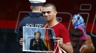Un migrant à son arrivée à la gare de Munich, le 5 septembre 2015.
