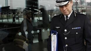 Metropolitan Police Assistant Commissioner John Yates leaves City Hall