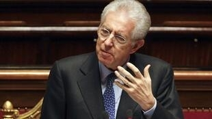 Italian Prime Minister Mario Monti reads his speech during a vote of confidence at the Senate in Rome November 17