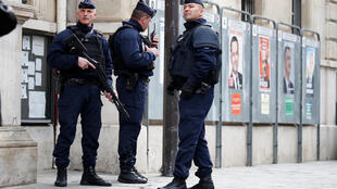 Police outside a Paris polling station during the first round of the French presidential election