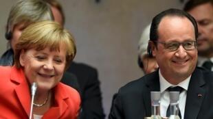 Франсуа Олланд и Ангела Меркель в ходе Петерсбергского климатического диалога 19 мая в Германии.