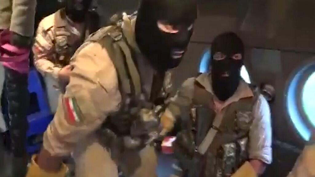 This image grab from a video provided by Iran's Revolutionary Guard official website allegedly shows Revolutionary Guard Corps preparing to board the British-flagged tanker Stena Impero in the Strait of Hormuz.