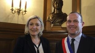 Steeve Briois, mayor of Hénin Beaumont, the day he took office, standing with National Front party leader Marine Le Pen