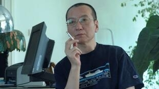 Chinese dissident Liu Xiaobo smokes a cigarette in this undated photo released by his family