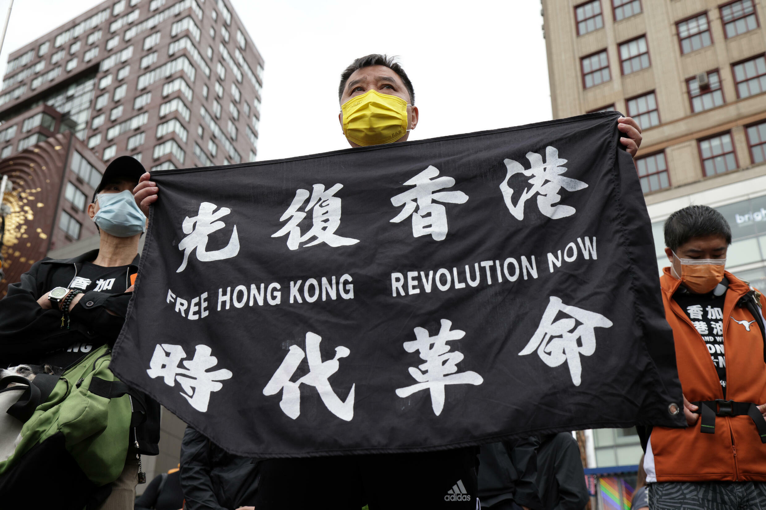 President Joe Biden's decision allows Hong Kong residents currently in the United States, such as these Hong Kongers protesting for democracy in New York in June 2021, to remain in the country for 18 months and to be allowed to work