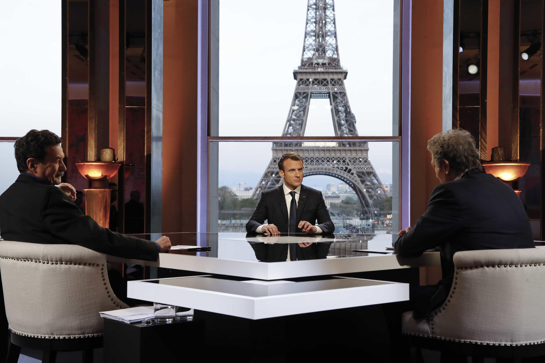 Edwy Plenel of Mediapart (L), President Emmanuel Macron (C) and Jean-Jacques Bourdin of RMC/BFMTV (R)