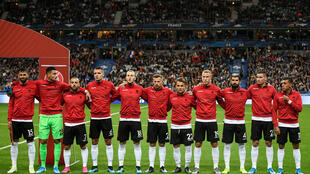 Players of the Albania national football team stand at attention to hear the national anthems before their Euro 2020 qualifying match with France at the Stade de France stadium on Saturday, 7 September 2019.