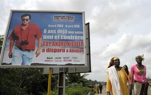 A placard in Abidjan reminds residents that Guy André Kieffer disappeared six years previously