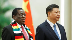 Xi Jinping and President of Zimbabwe Emmerson Mnangagwa attend a welcoming ceremony before talks at the Great Hall of the People in Beijing, China April 3, 2018. REUTERS/Thomas Peter