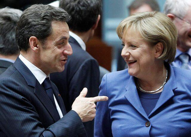French President Nicolas Sarkozy talking to German Chancellor Angela Merkel in Brussels on 25 March, 2010.