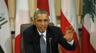 Barack Obama s'exprime à Washington face aux chefs militaires de 22 pays participant à la coalition contre l'organisation Etat islamique, le 14 octobre 2014.