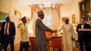 Nigerian President Muhammadu Buhari arrives Washington DC shaking hand with spokesman Shehu Garba