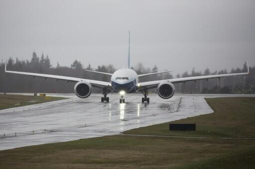 A Boeing 777X airplane taxis for its first flight at Paine Field in Everett, Washington