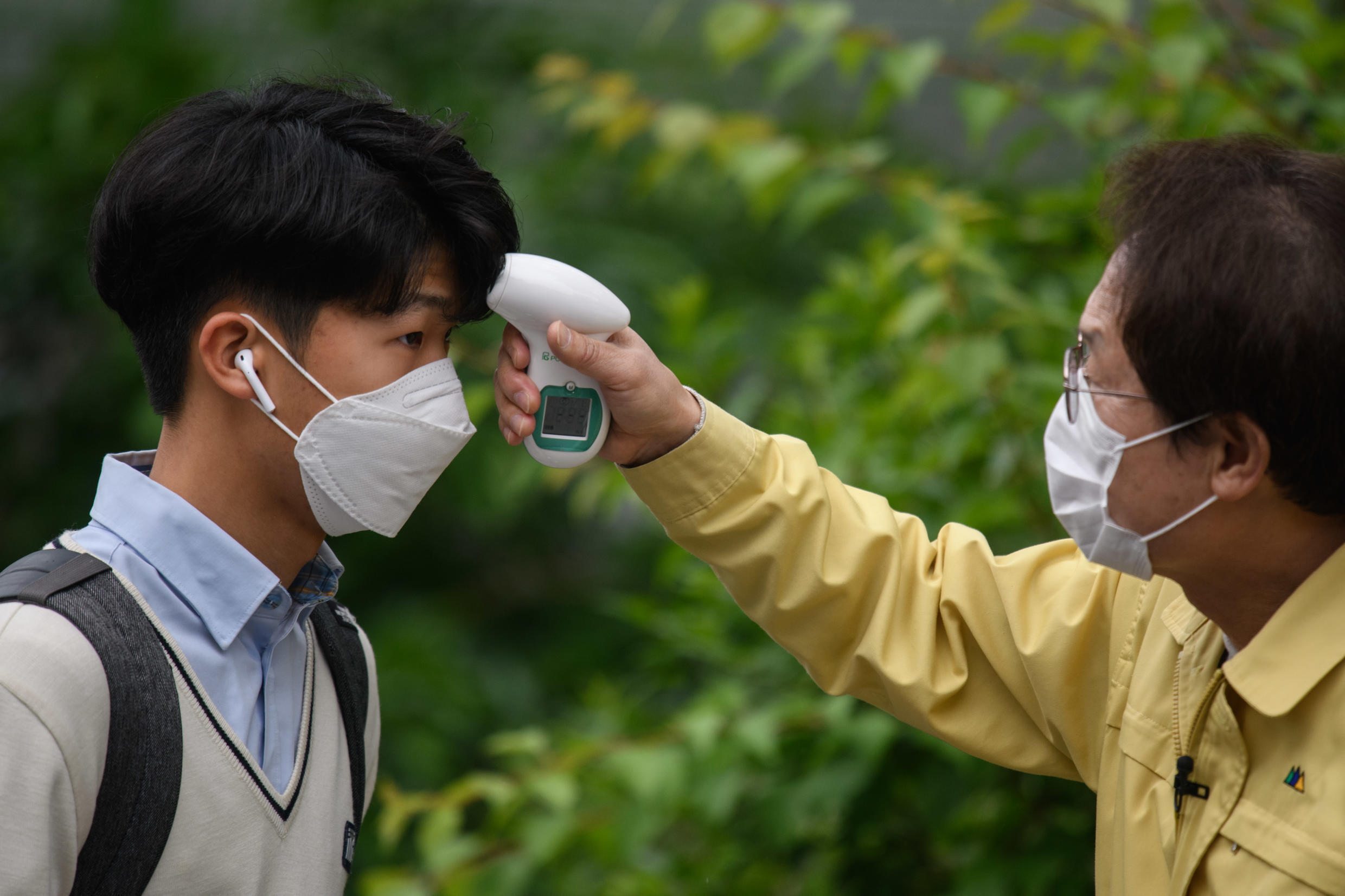 Hundreds of thousands of South Korean students have returned to school after a delay of more than two months because of the coronavirus outbreak