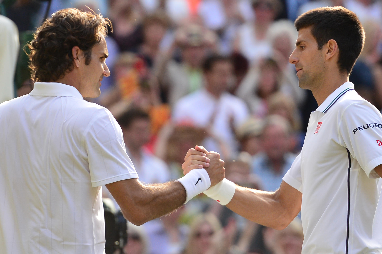 Roger Federer (L) and Novak Djokovic at Wimbledon on July 6, 2014.