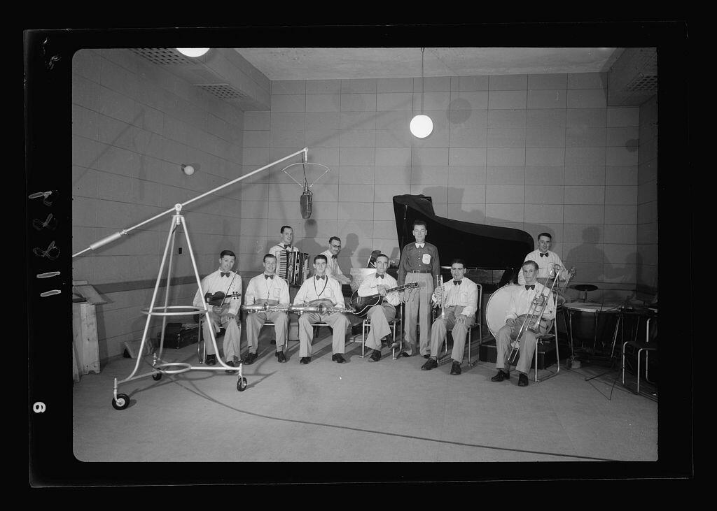 Photo taken in Palestine Broadcasting Service Studios, Jerusalem. Military band in studio, broadcasting