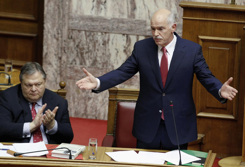 Greek Finance Minister Evangelos Venizelos applauds PM George Papandreou in parliament