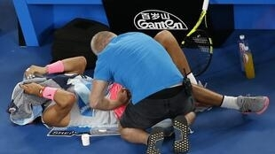 Rafael Nadal receives medical assistance during his match against Marin Cilic