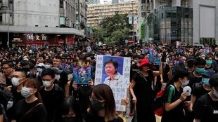 Des manifestants défilent à Mong Kok, Hong Kong, le 3 août 2019.