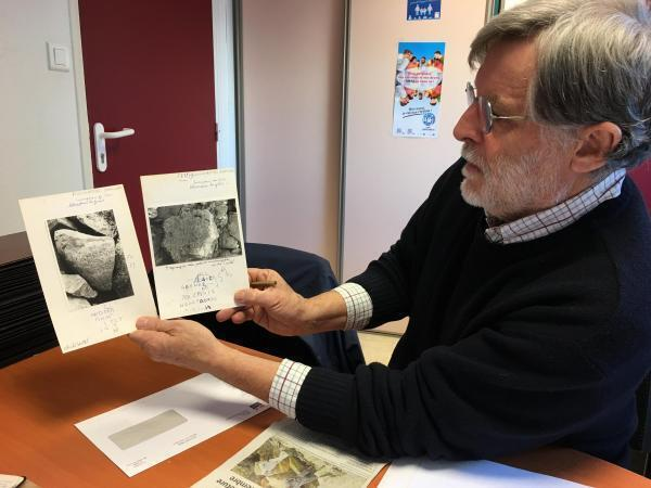 Breton language teacher and specialist François-Pol Castel holds photographs of the stone taken by his uncle in 1979.