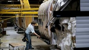 A worker assembles a camping trailer at the Riverside RV factory in Indiana -- experts consider recreational vehicles to be bellwethers of the American economy