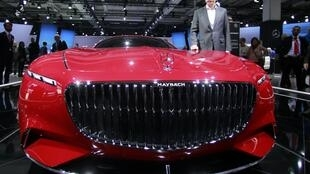 Daimler CEO Dieter Zetsche poses near the Mercedes Maybach 6 car before the Daimler annual shareholder meeting in Berlin, German