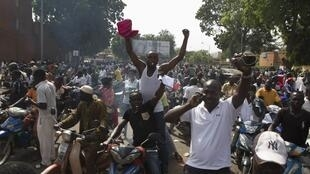 Celebration in the streets of Ouagadougou after former president Blaise Compaoré steps down, October 31, 2014.