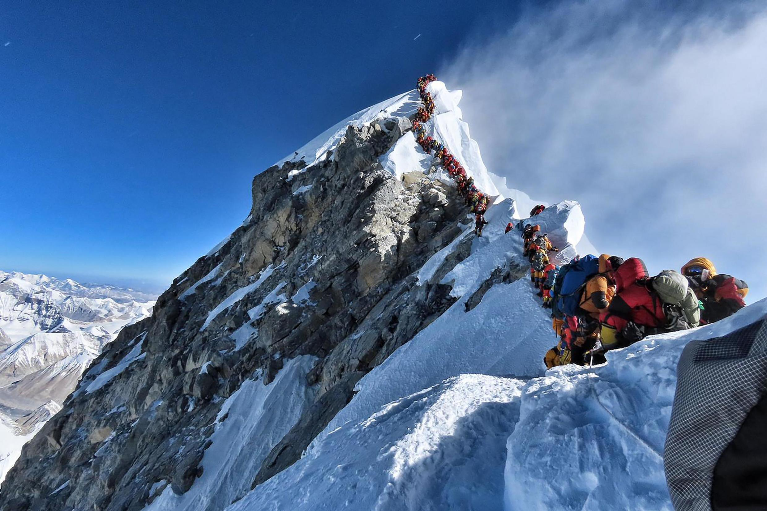 Mountain climbers lining up to stand at the summit of Mount Everest earlier this season.
