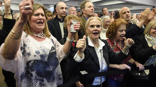 Members of the right-wing UMP celebrate gains by their party in last weekend's departmental elections