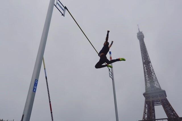 An acrobat at the ceremony to cekebrate Paris's success