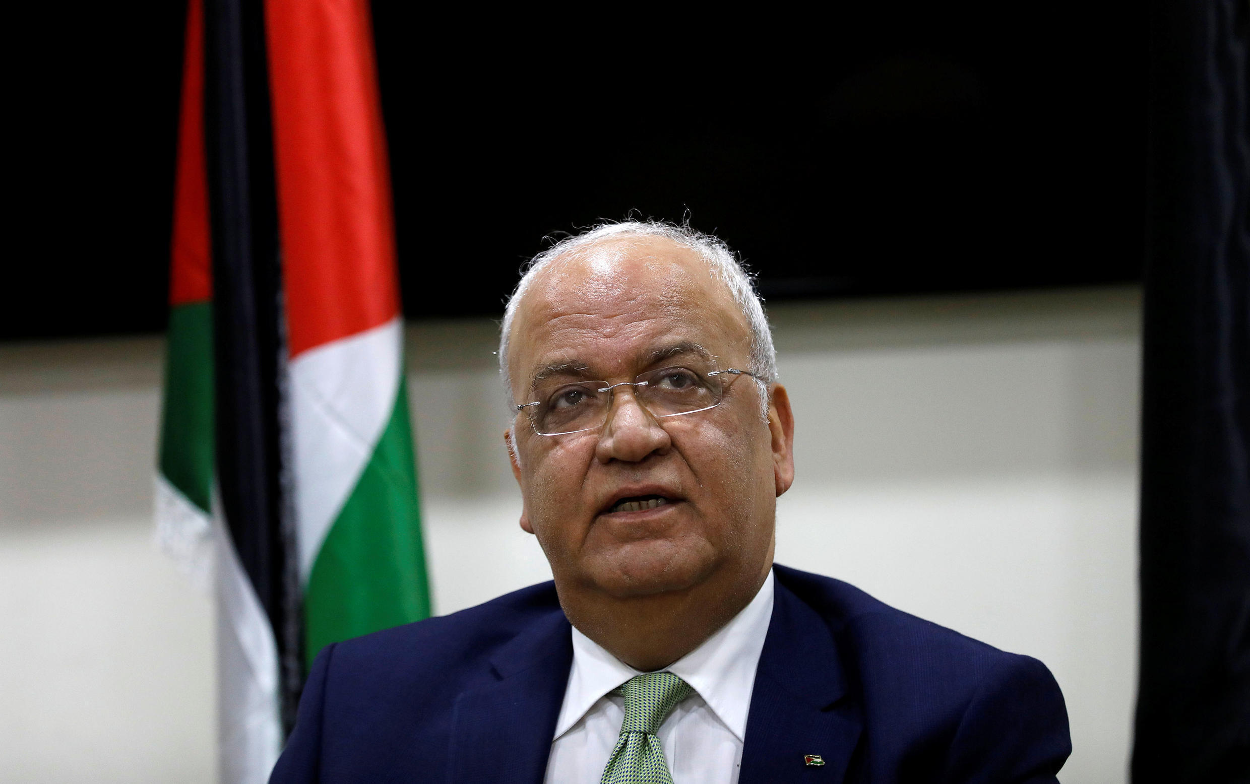 Chief Palestinian negotiator Saeb Erekat looks on during a news conference following his meeting with foreign diplomats in Ramallah, in the Israeli-occupied West Bank