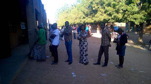 Voters line up at the Lycee le Reveil polling station in Ouagadougou, 29 November 2015