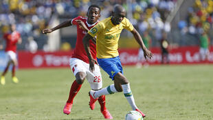 Anele Ngcongca (R) playing for Mamelodi Sundowns against Al Ahly in a CAF Champions League quarter-final last March
