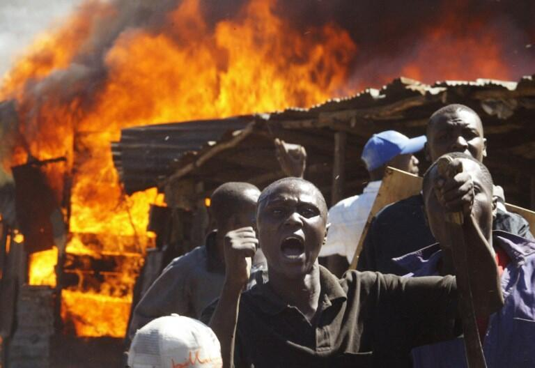 Residents of the Mathare slum in Nairobi shout at demonstrators during clashes between rival groups, January 2008.