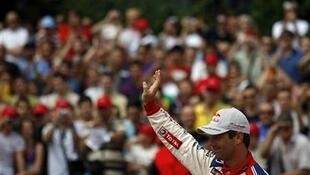 Sébastien Loeb of France waves to spectators during a demonstration event in central Sofia July 4, 2010.