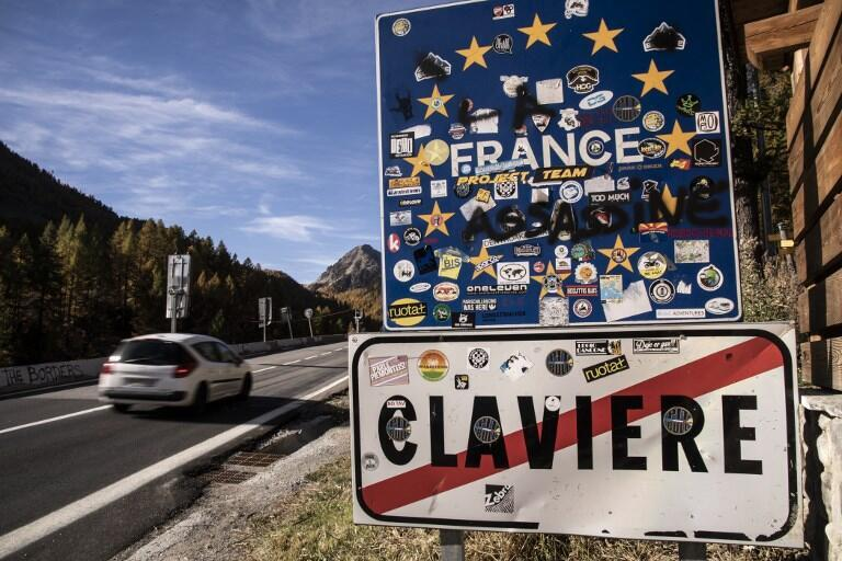 A car drives into France at the Italian - French border on October 21, 2018 in the Alpine border town of Claviere, some 100 kilometers west of Turin.