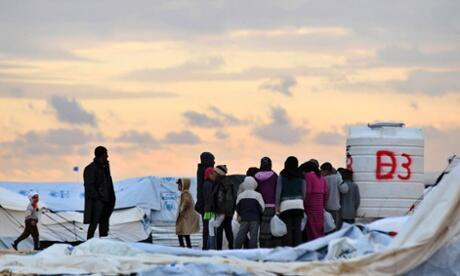 Syrian refugees queue for water at the Za'atari refugee camp in Jordan