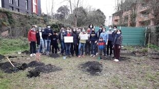 """Students from Marcelin Berthelot high school in Toulouse are planting trees in a biodiversity corridor, as part of an """"écolycée"""" or Green high school group initiative. March 2021."""