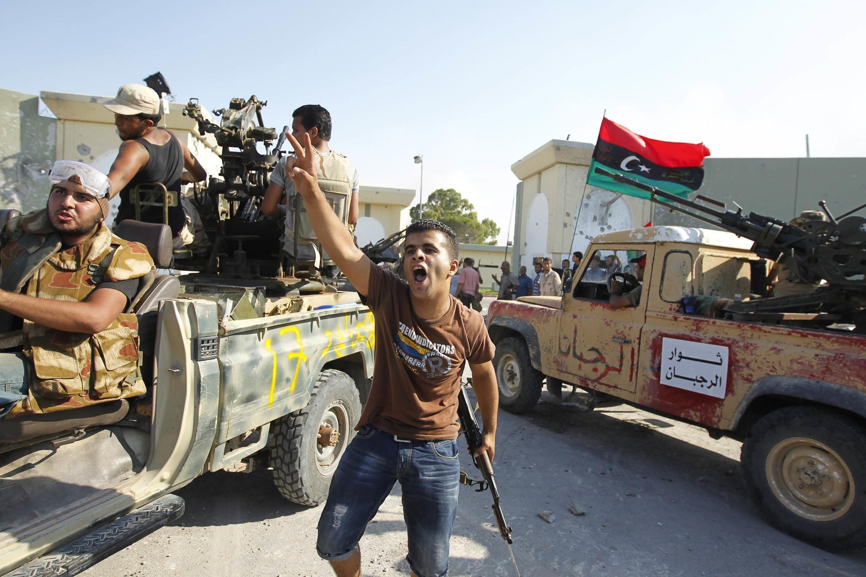 Rebels celebrated their invasion of Kadhafi's Bab al-Aziziya compound.