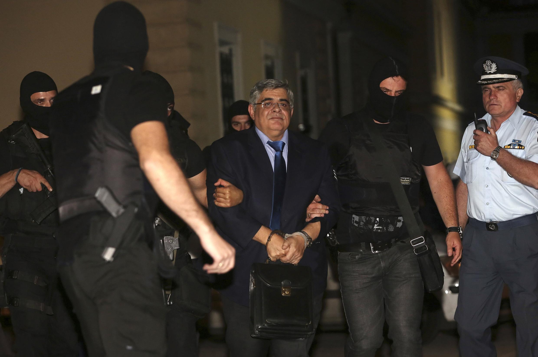 Nikos Michaloliakos, lãnh đạo đảng tân phát xít Hy Lạp Bình minh vàng  bị tạm giam và truy tố ngày 3/10/2013.