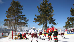 The Vegas Golden Knights, in the dark jerseys, and the Colorado Avalanche, in the white, had their NHL Outdoor game at Lake Tahoe halted after one period by poor ice conditions with plans to finish the game at night