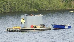 Investigators continue the search for missing people from the Utoeya youth camp with an underwater camera off the island in Tyrifjorden lake 26 July  2011.