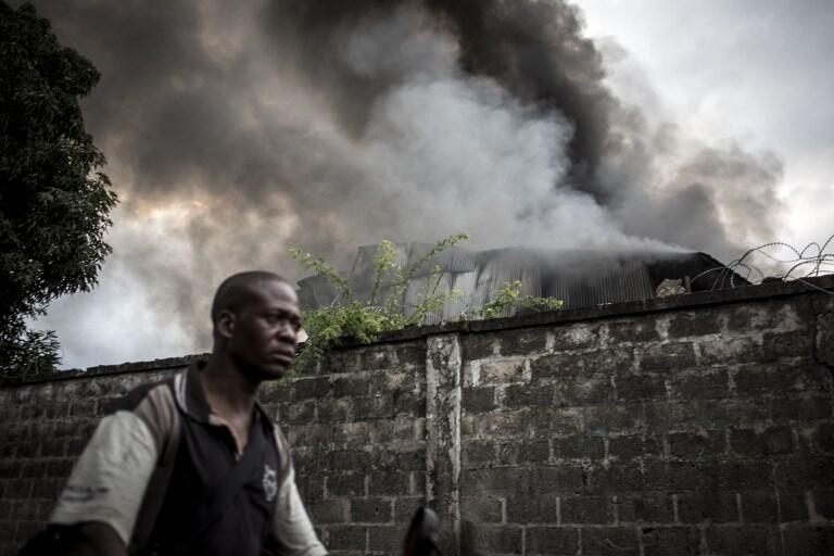 Smoke rises from the electoral commission's warehouse in Kinshasa, 13 December 2018.