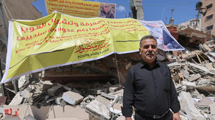 Samir al-Mansour stands in front of the rubble of his bookshop in Gaza City. 'Forty years of my life were obliterated in less than a second,' he said