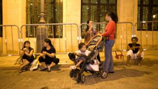 Ces 'nounous' des Philippines travaillent à Beyrouth, au Liban.