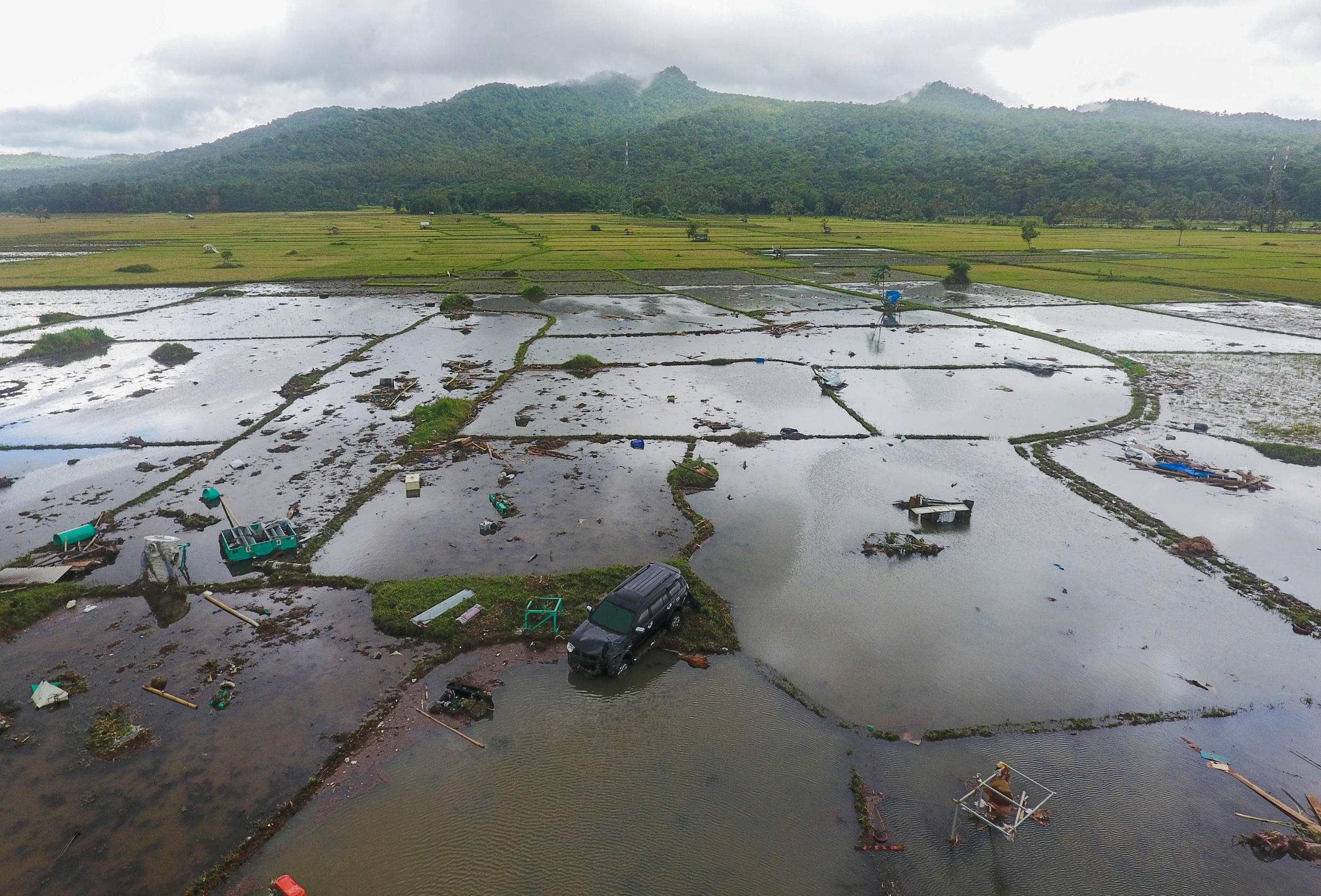 Rescue operations after the December 2018 tsunami in Indonesia have been marred by torrential floods and difficult accessibility  to remote areas