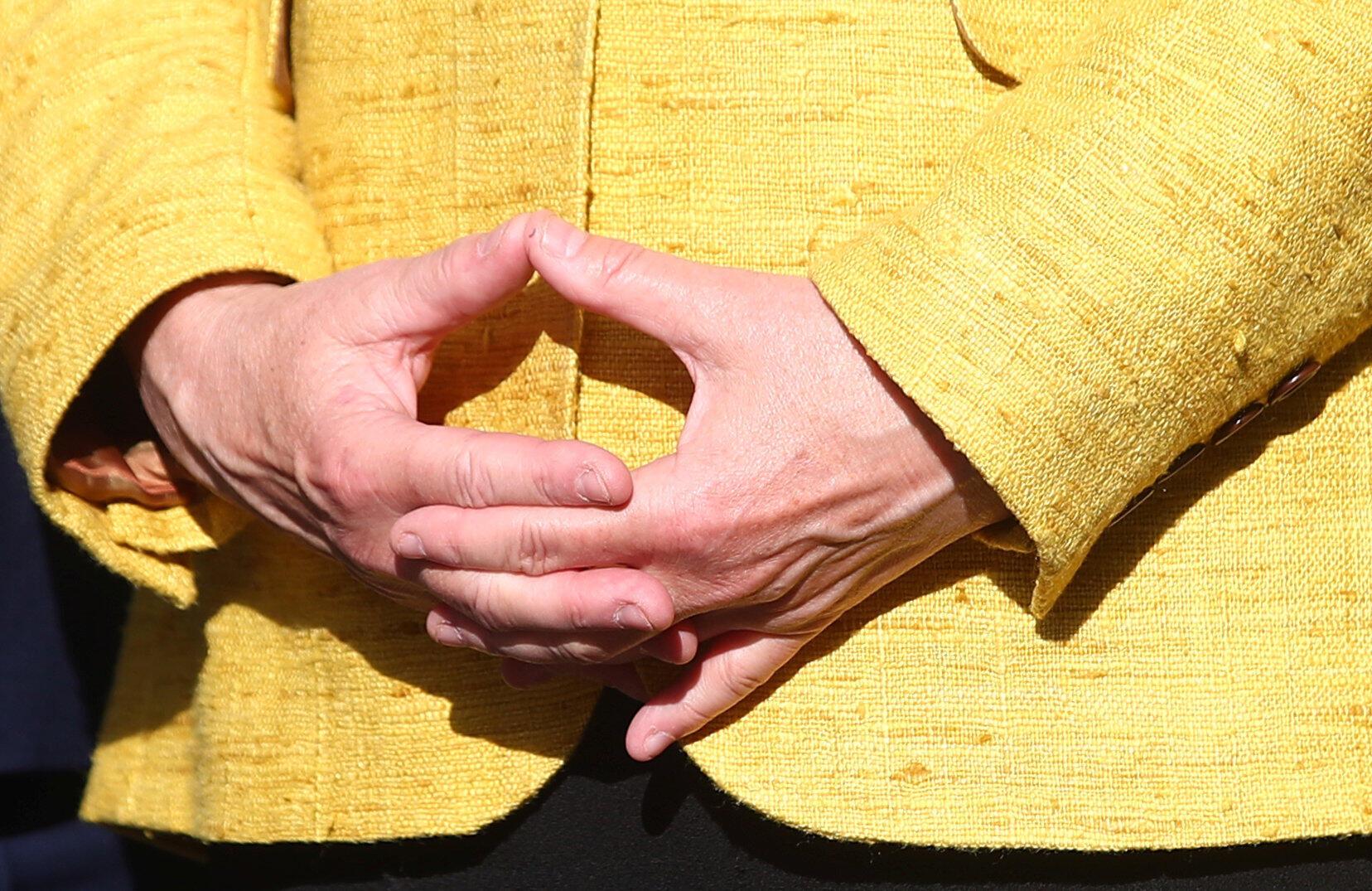 «Фирменный жест» Ангелы Меркель
